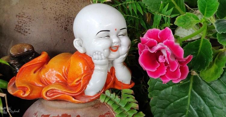 Jayashree Rajan's garden apartment tour on The Keybunch: buddha sculpture in green garden