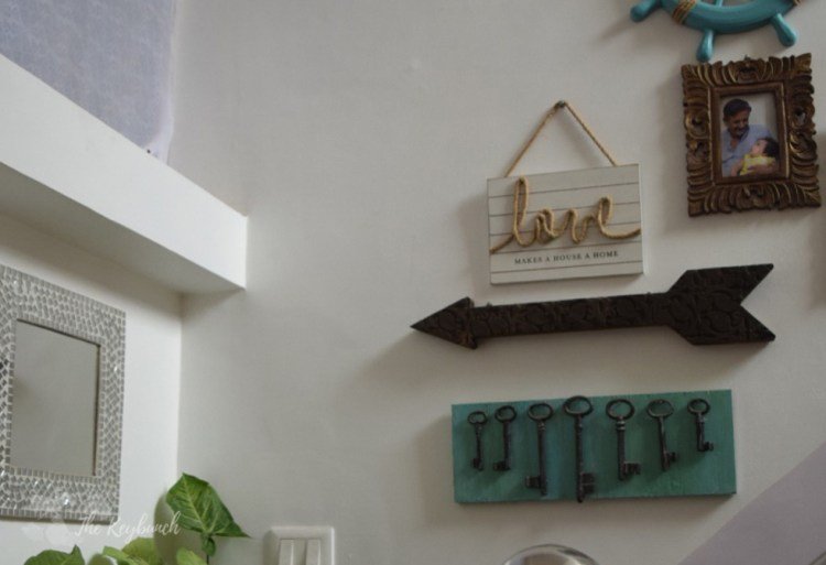 Home decor Tour by Ankita and Sitanshu's in Lucknow - the gallery wall on stairway