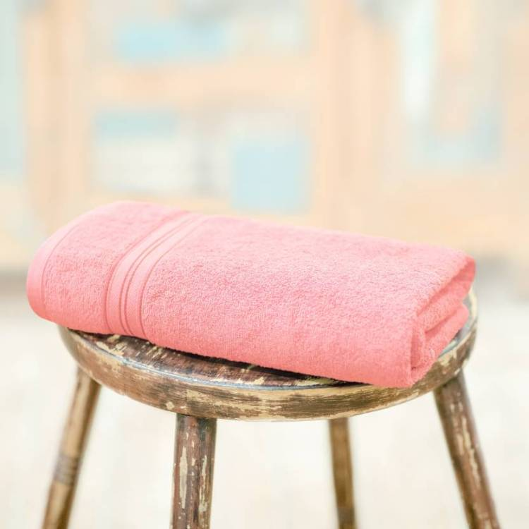 A bath towel in fresh peach color