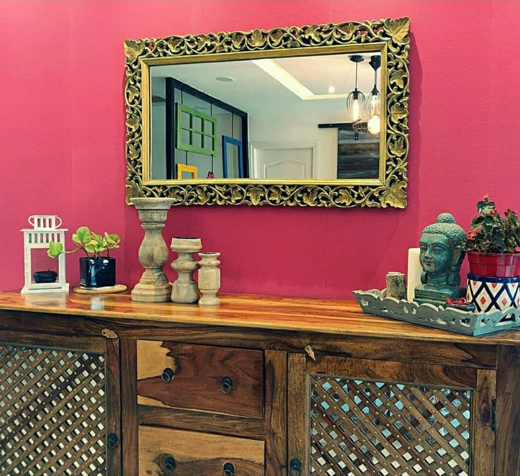 Home style Tour with Rajni in Hyderabad: the collection of candle holders, plants and vintages on the cabinet and decorative mirror makes the room beautiful