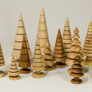 A forest of hand turned wooden Christmas trees