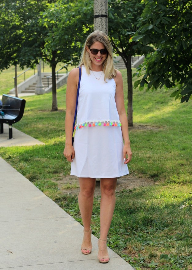 Walking in a white Shein summer dress