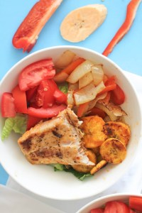 A spicy mahi mahi bowl with fried plantains that's filled with flavor!
