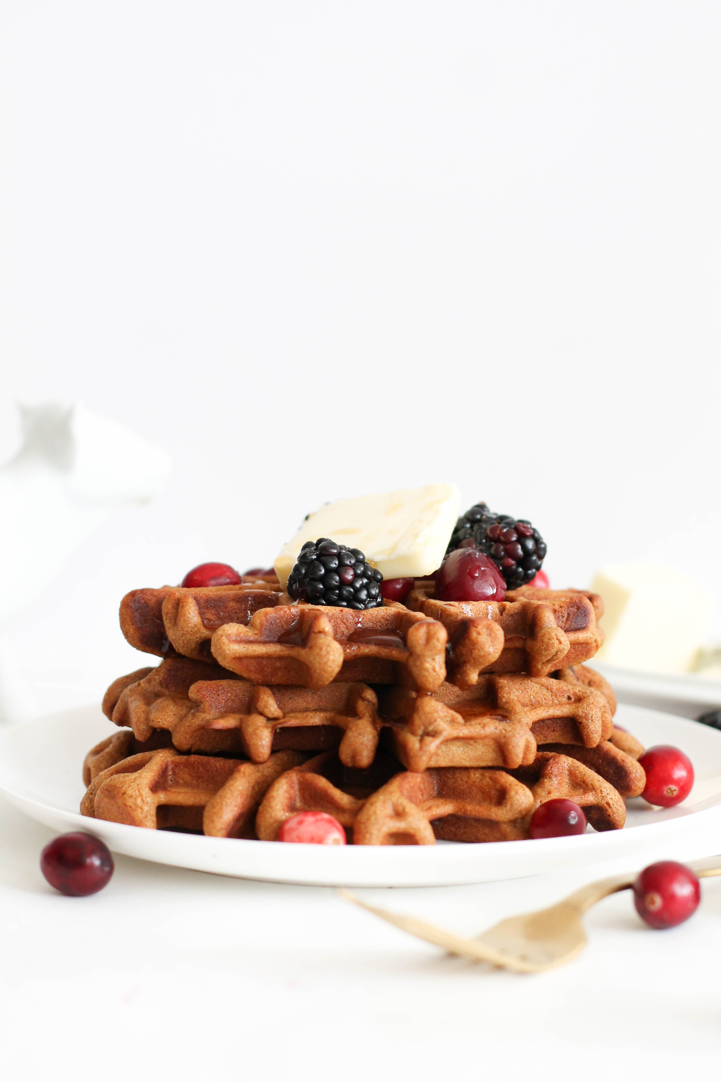 These gingerbread waffles are fluffy, crispy, and full of flavor! They require one bowl, have just six main ingredients, and are the perfect Christmas morning breakfast. Serve them with maple syrup and fresh cranberries for a delicious treat.