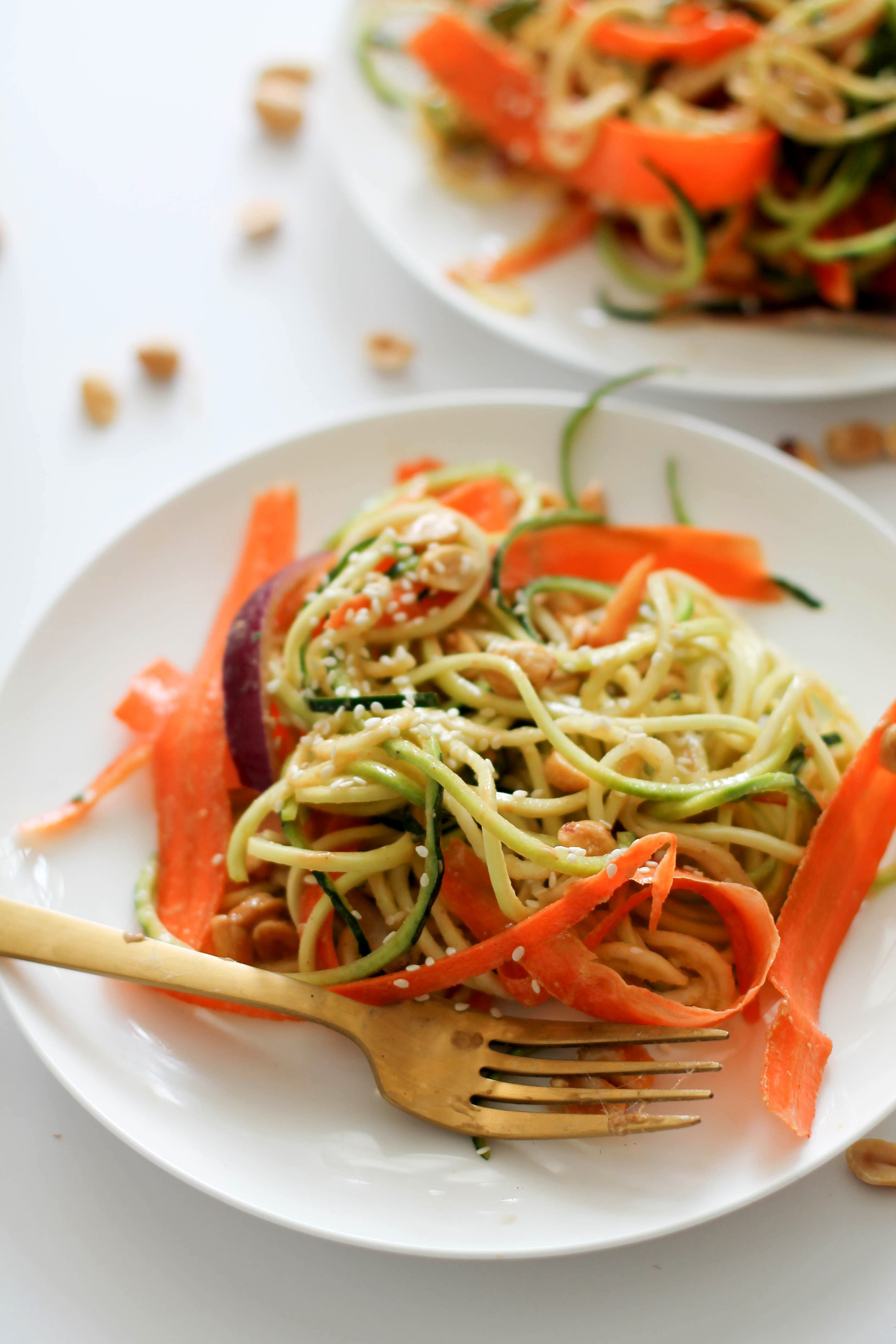 This zucchini noodle pad thai is refreshing, easy to make, and absolutely delicious. It's filled with peanut flavor, crunch, and takes less than 15 minutes to make.