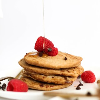 These vegan & gluten free chocolate chip pancakes are fluffy, naturally sweet, and filled with chocolate flavor. They take 30 minutes to make and are the perfect Sunday brunch dish. Plus, they're refined sugar free and filled with flavor.