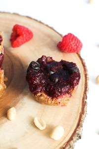 These peanut butter & jelly cups are vegan, gluten free, and the perfect dessert or snack. They're filled with natural sweetness, healthy fats, and peanut butter! They make for a great snack or light dessert.