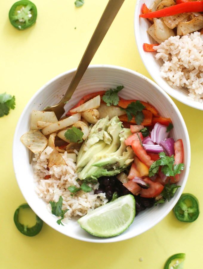These 20 minute fajita burrito bowls are vegan, gluten free, and the perfect quick dinner! Filled with plant based protein, healthy fats, complex carbs, and flavor, these are perfect for a satisfying meal.