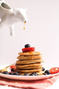 These fluffy gluten free protein pancakes are the perfect post workout breakfast! Filled with flavor, protein, and can be made in a blender, they take 20 minutes and are absolutely delicious.