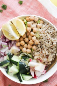 This greek quinoa buddha bowl is vegan, gluten free, full of plant protein, and requires less than 30 minutes to make! It's nourishing, full of flavor, and makes for a great lunch.