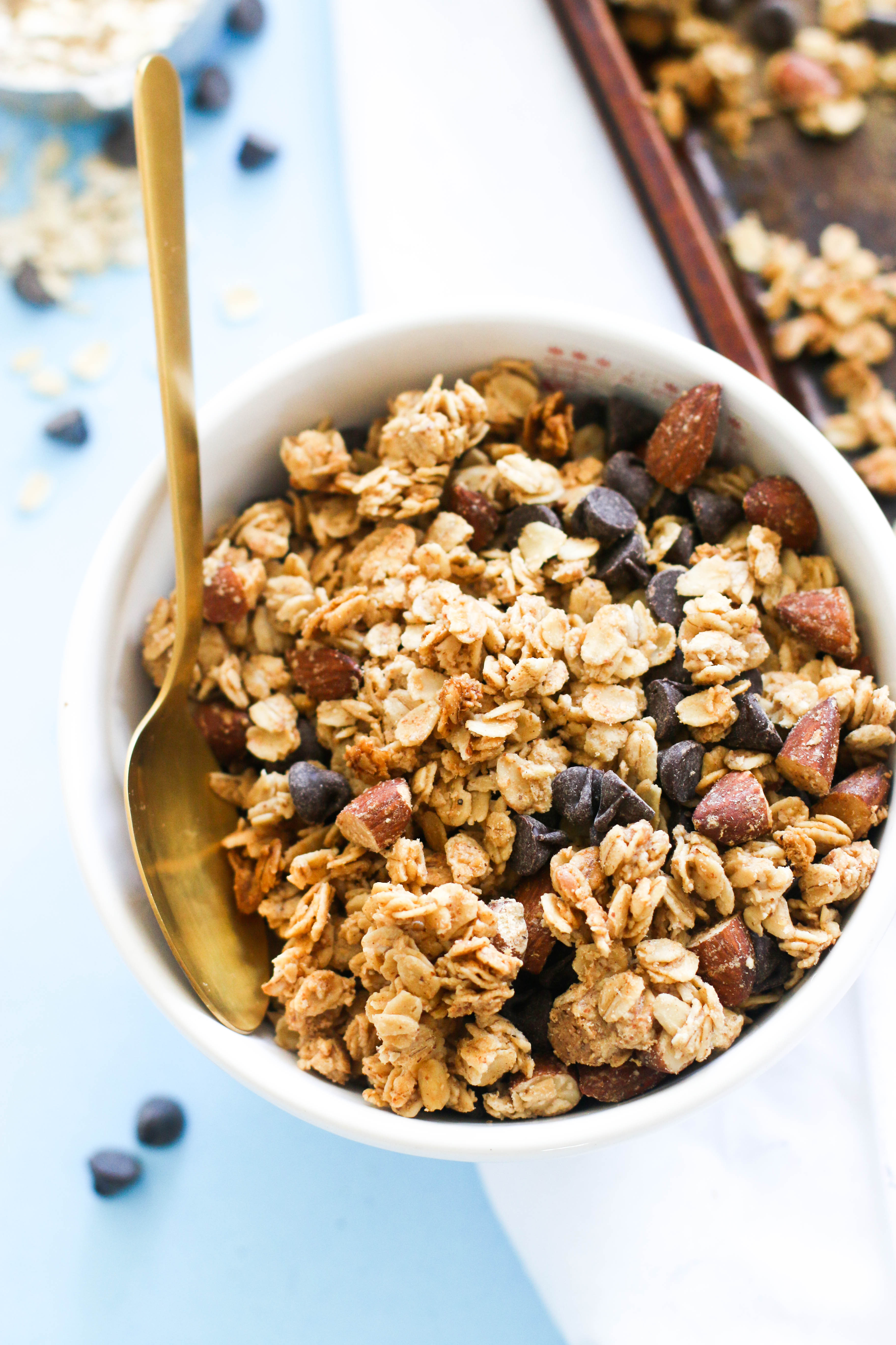 This almond butter chocolate chip granola is vegan, gluten free, full of flavor, and the perfect breakfast! Pair it with some almond milk and fruit for an easy meal that leaves you satisfied, or you can top it on yogurt, oatmeal, smoothies, or potatoes!