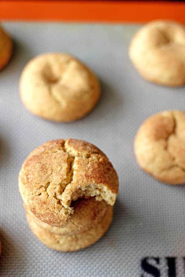 Soft & chewy snickerdoodles rolled in cinnamon sugar. They're sweet, a little bit spicy, soft and pillowy on the inside and crunchy on the outside | thekiwicountrygirl.com