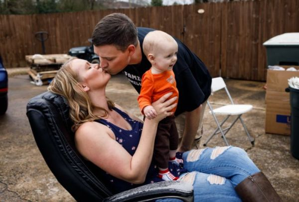 Matt Colvin with his wife, Brittany, and son