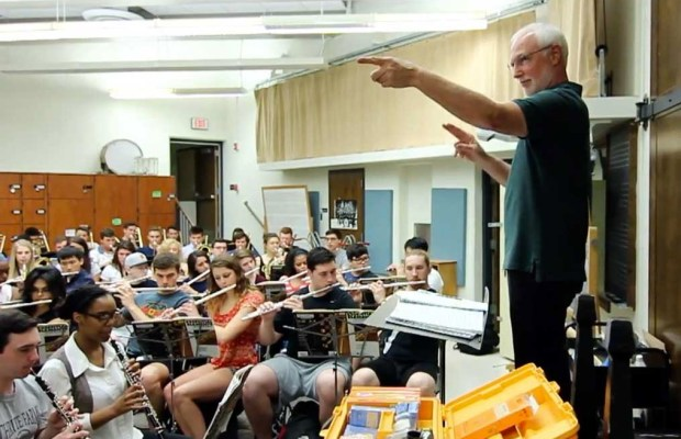 Professor of Music Tom Evans conducts the Instrumental Methods class in April. The band will embark on a world tour in September. (Hadley Harrison / The Index)