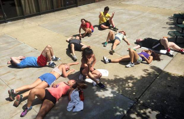 Bootcamp students pass out after workout. (Ayla Hull / The Index)