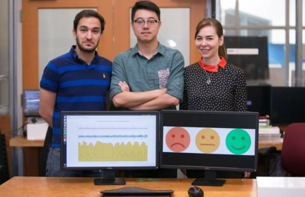 From left to right: MIT PhD students Fadel Adib and Mingmin Zhao with Professor Dina Katabi (Photo courtesy of Jason Dorfman).