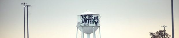 """Cosme and Lucka's graffiti """"Free the Water"""" on Detroit water tank (Antonio Cosme)."""