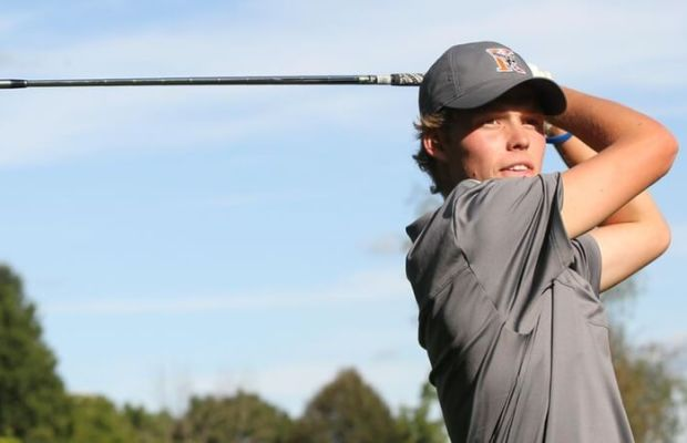 Kalamazoo College Golf player looks down course after shot (Photo courtesy of Kalamazoo College).