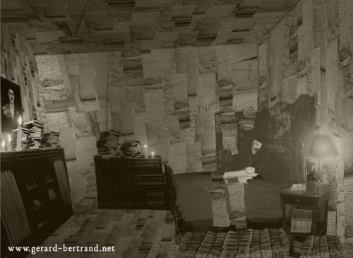 Black and white photo of Marcel Proust's bedroom walls at Rue Hamelin, covered in drafts