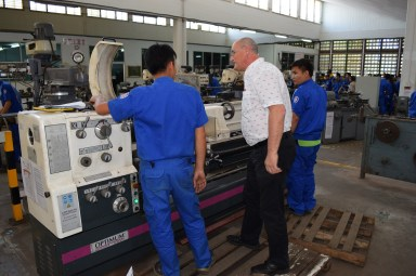 Bernhard Fuerst, Vocational Education Advisor, looks at a milling machine