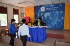 Souvanh Vong, English teacher at the secondary school Ban Phang Heng, helps during the handover ceremony
