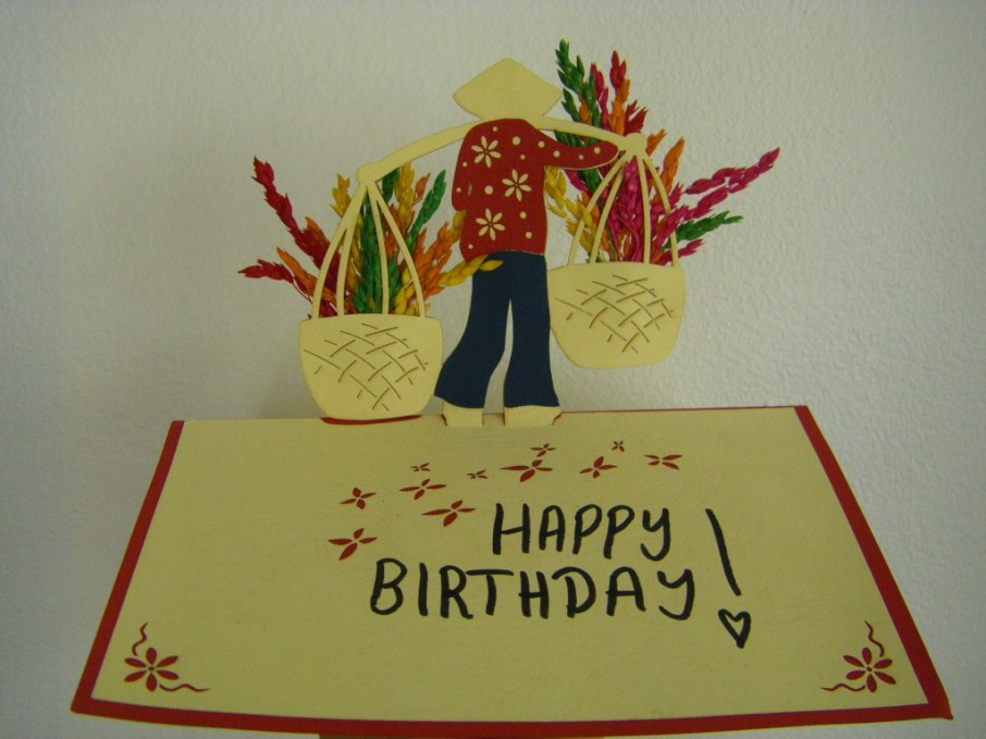 Birthday card showing a silhouette of a man working in a rice field