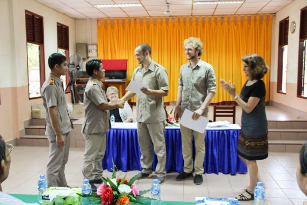 David Schrep hands over the certificates to his tandem-teachers Sauvanh Vong & Bounleud Sengsavangvong (teachers at Phang Heng secondary school)