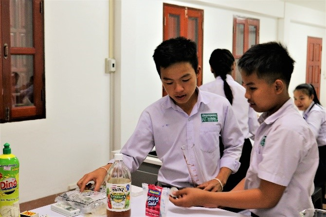 Two boys get their material ready for an experiment...