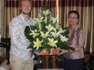 Johannes Zeck hands over a flower bouquet