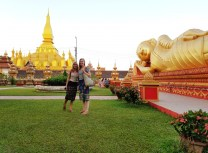 That Luang in Vientiane, the country's national symbol, and us in traditional Lao sinhs