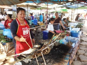 Buying fish and other food at the local market during lunch break