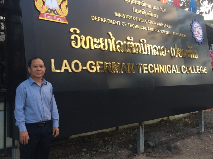 Mr Khamsavay in front of the LGTC-sign