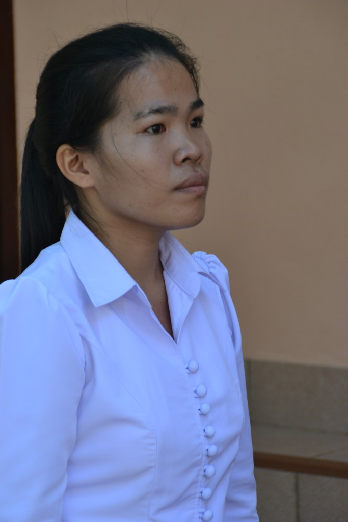 Ms Saysamone in front of the Science Lab in Ban Phang Heng Secondary School