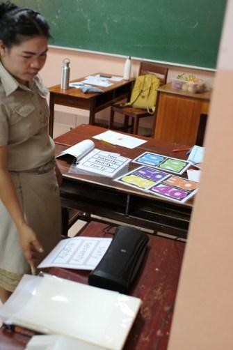 Ms Bounpheng laminates her material