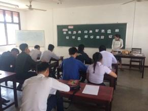 "Akina teaches English to the ""GM2"" students"