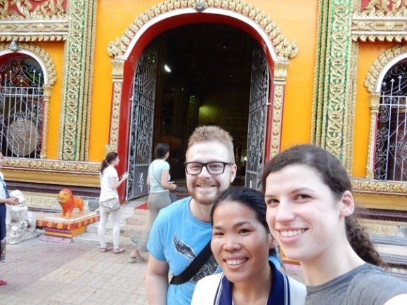 Fabian, Ms Saysamone and Svenja visit a temple in Vientiane