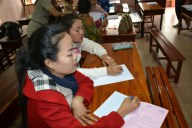 """Ms Mittaphone and Ms Phovang (""""Noy"""") brainstorm about pronunciation difficulties for Lao EFL learners"""