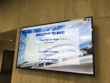 ...were welcomed business-style on an LCD screen...