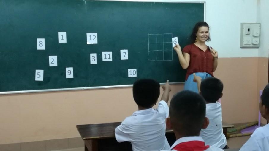 """Teacher Pauline"" explaining the game ""Bingo"" in Maths Club"