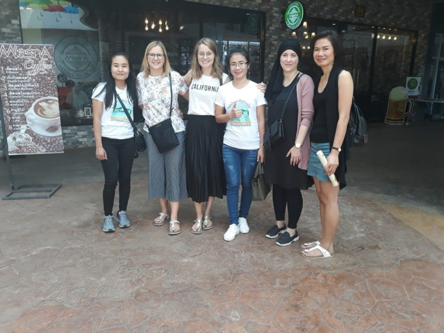 Ms Moukdala, Nicole, Patricia, Ms Ba, Dilara, and Ms Ket in front of the View Mall