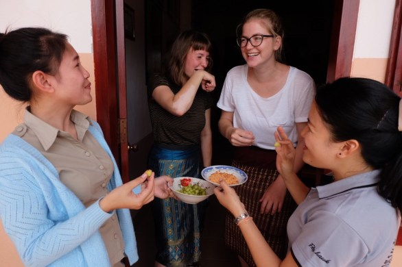 Volunteers Marleen and Anja try some sour fruit offered by the Lao teachers Ms Malaithong and Ms Nalee (hence these elegant facial expressions!)