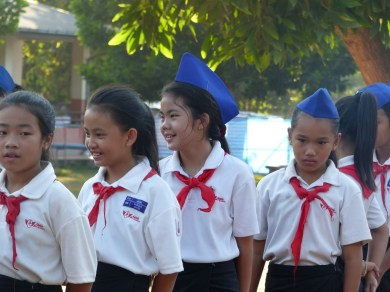 High performers at primary school wear red neckties and blue hats