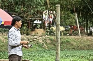 Fisherman, Pheuksa Garden, Vientiane Province