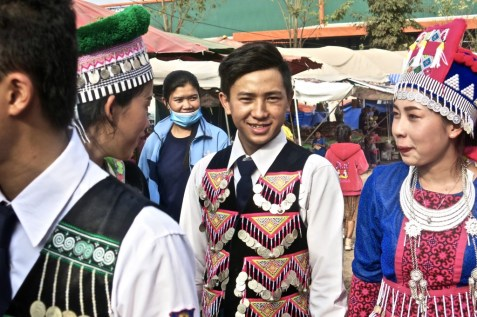Man in traditional Hmong vest
