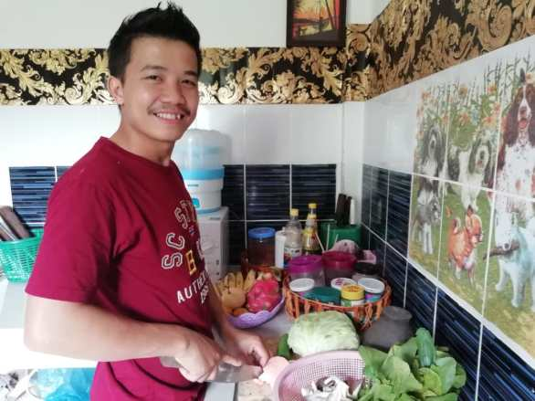 Ms Akina's husband prepares dinner for the family.