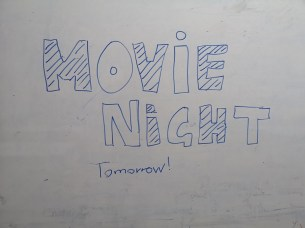 Movie Nights are either advertised directly in class on the Whiteboard...