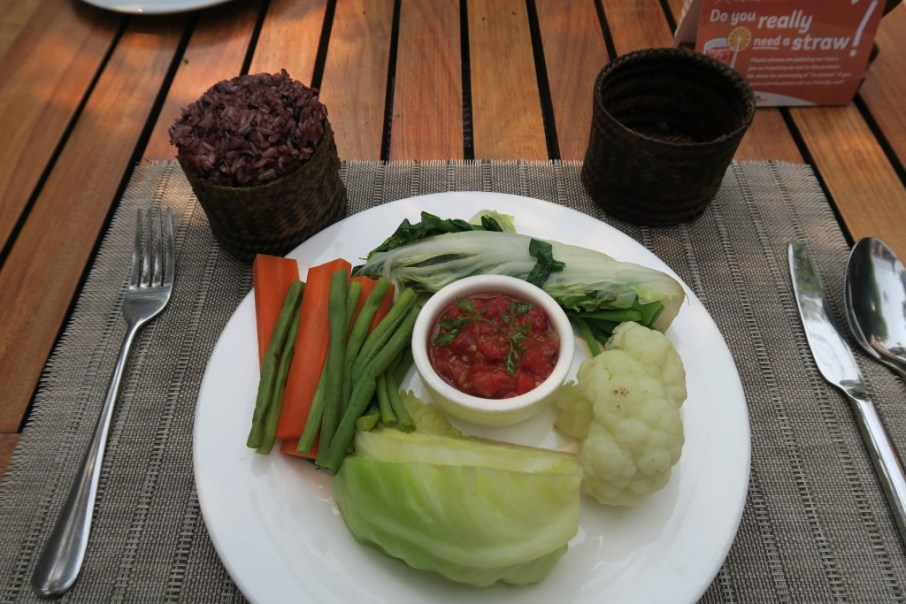 Steamed vegetables with a tomato dipping sauce, served with black rice