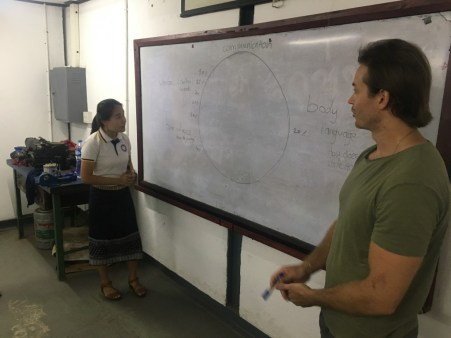 Ms Moukdala Keomixai and Thomas complete the pie chart together.