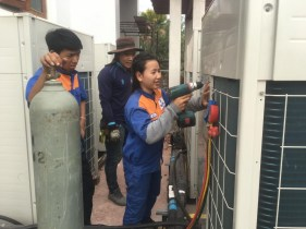 Air condition installation tasks at a local company in Laos