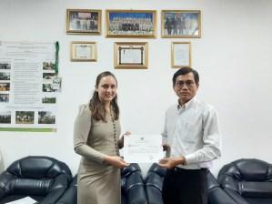 The Vice-President Dr Bounheuang Ninchaleun hands me the certificate for my teaching at SKU.
